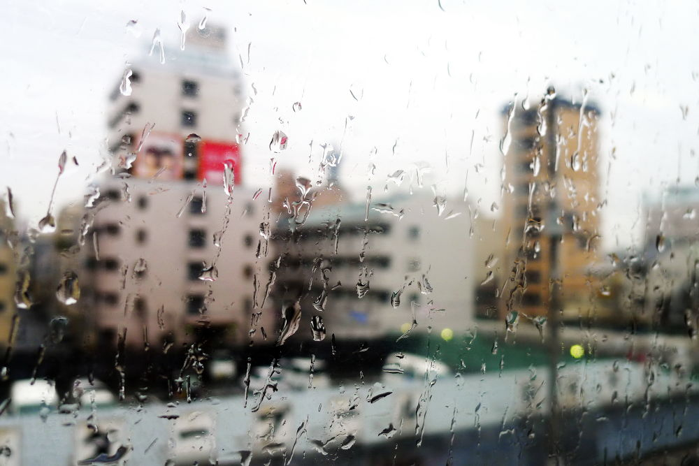 Japan 2012; A rainy day on the train in Osaka by Perry Haines Photography
