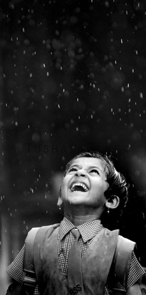 A school girl enjoy first rain drops in Mumbai by manetushar
