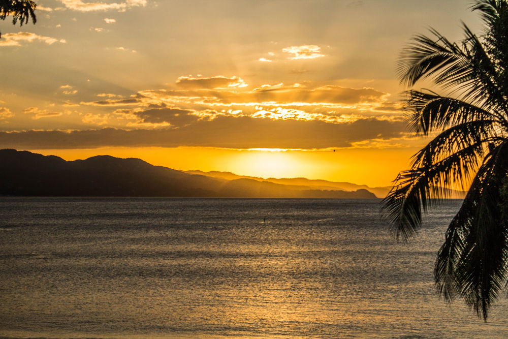 Sunset in Montego Bay, Jamaica. by Sadiki Morris