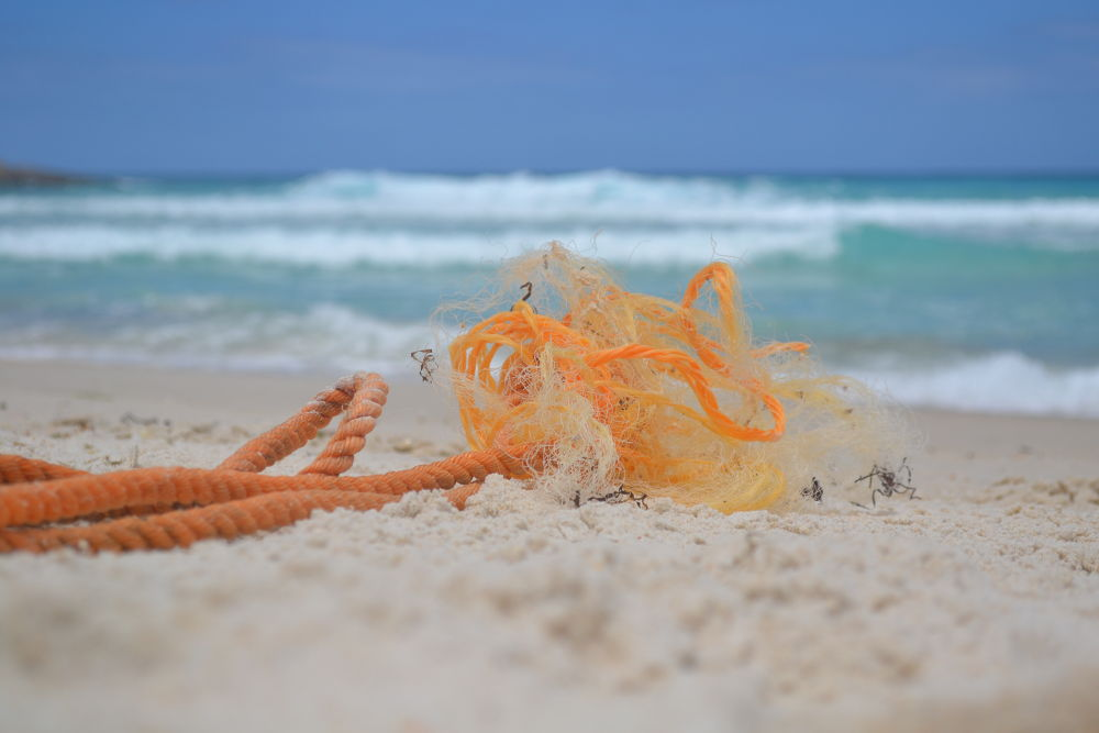Stranded rope on the beach by Corey Battersby Photography