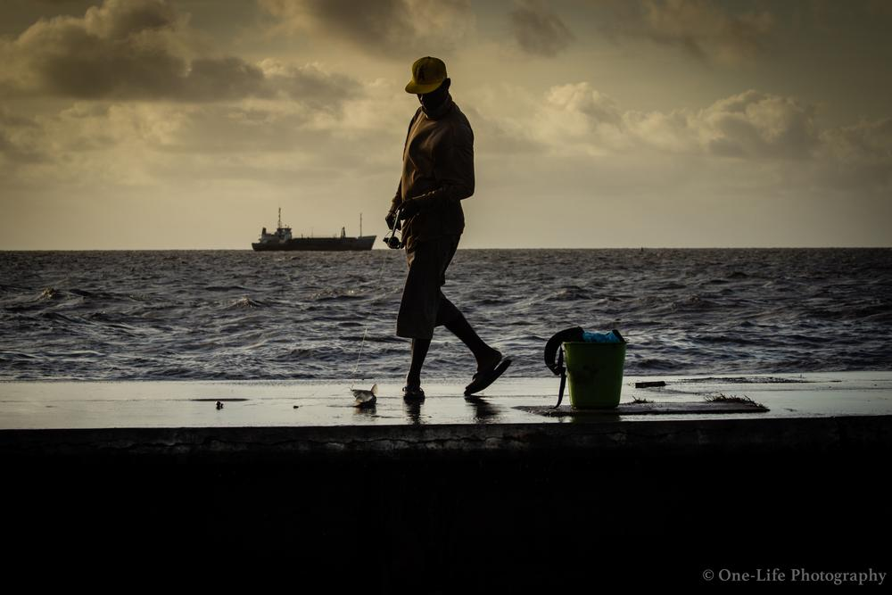Photo in Random #sea #fishing #ocean #fisherman #seawall