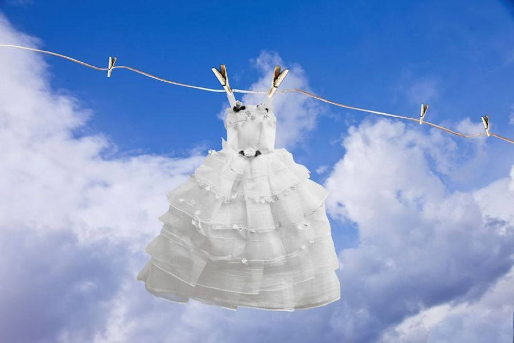 Clothesline with sky as background by Grace Olsson
