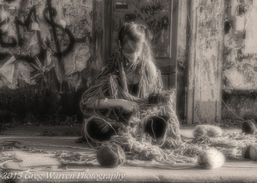 Photo in Street Photography #street photography #blindfolded #knitting #black and white