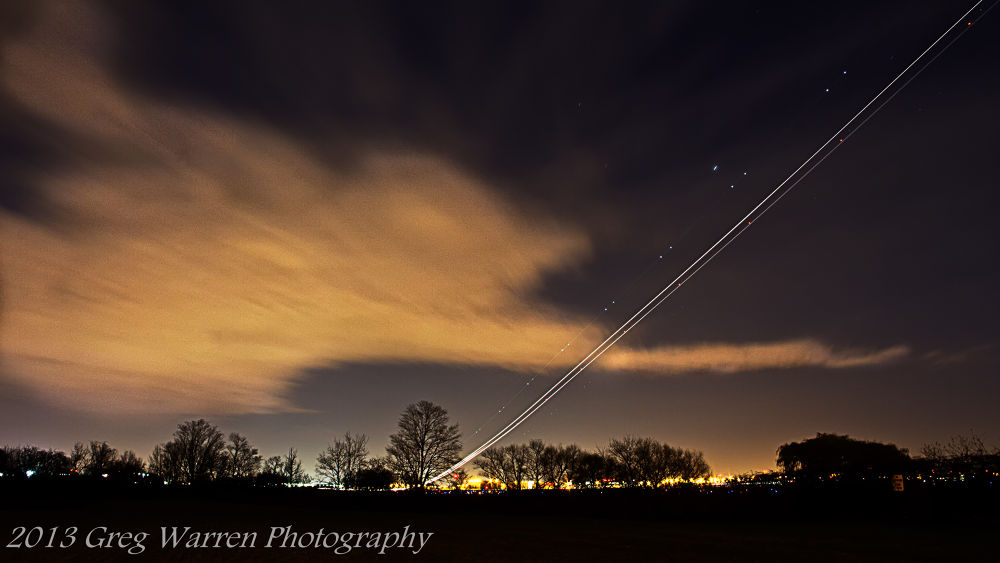 Light trail of a plane taking off from Pearson International Airport by Greg Warren