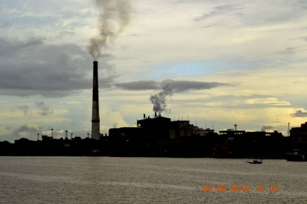 Photo in Random #river #india #evening #air pollution #ganga #pollution #factory #chimney