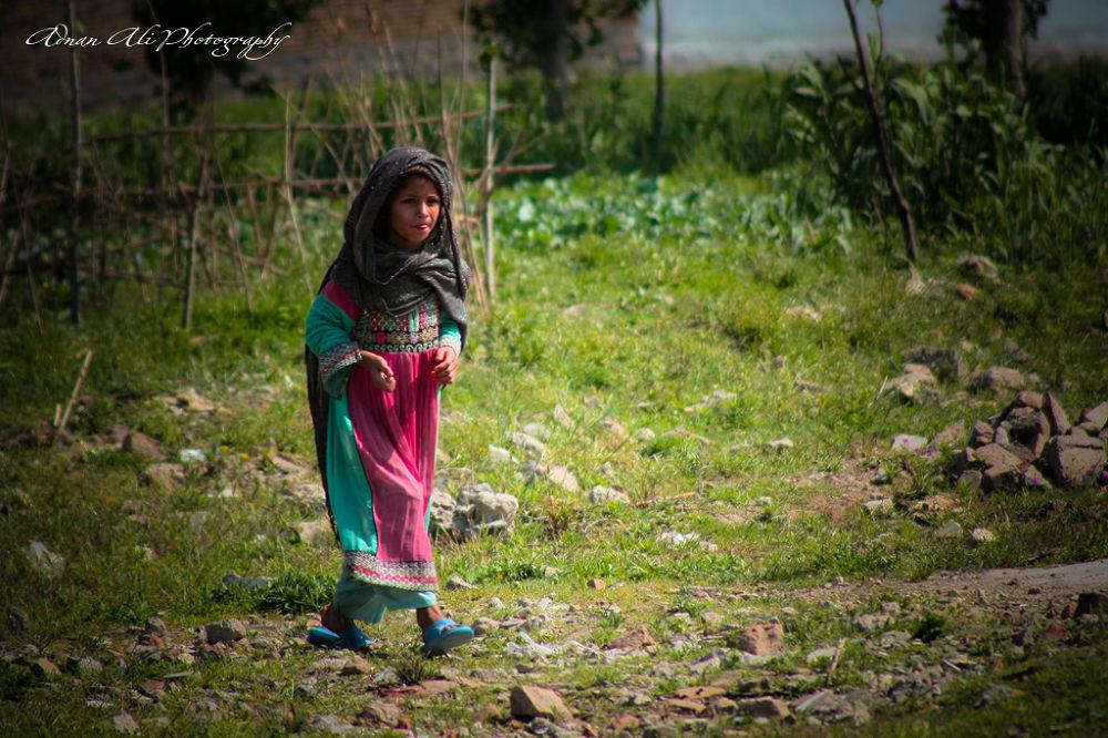 Afghan Girl walk on the Demolish Osama bin laden compound Abbottabad. by adnanali