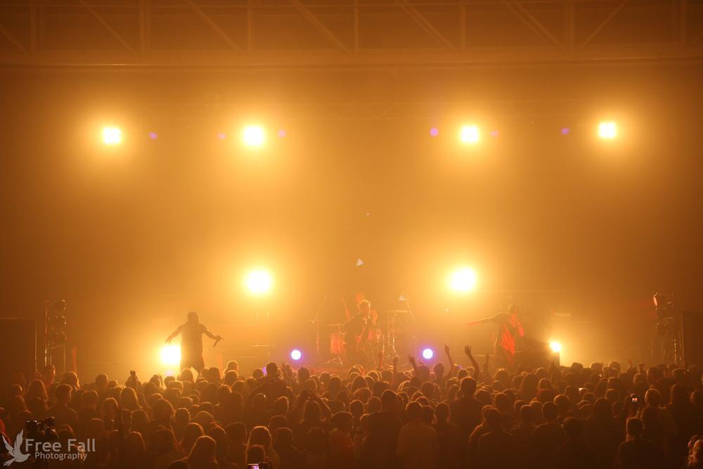 Photo in Concert #concert #revo #revolutiontour #revolution #lights #people #strobe #strobelights #sing #singing #dancing #dance