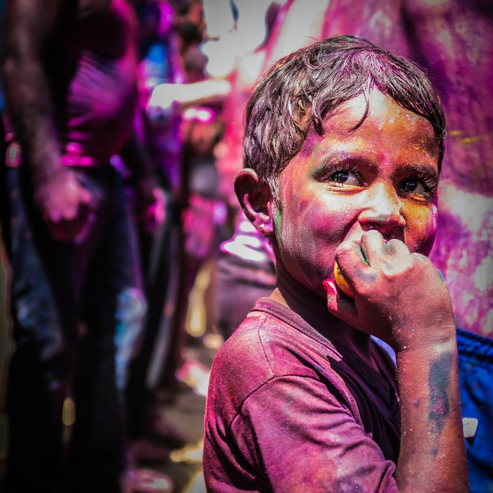 nice child during holi festival by Maxime Nourry