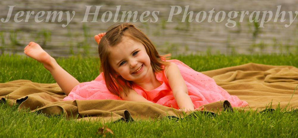 Little girl in pink by Jeremy Holmes