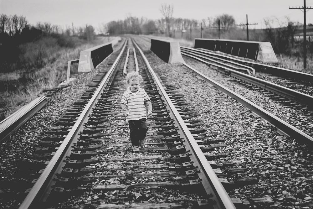 lonely boy/train tracks/black and white by Donna