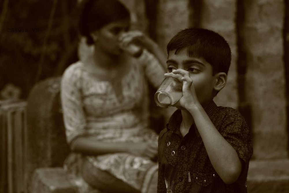 Having a tea ! by Achu