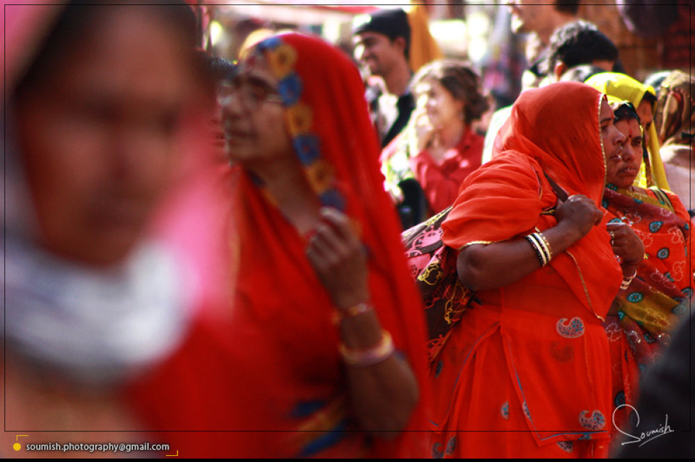 Photo in Street Photography #travel #india #travel photography #street photography #people #culture #fair #rural #red #candid