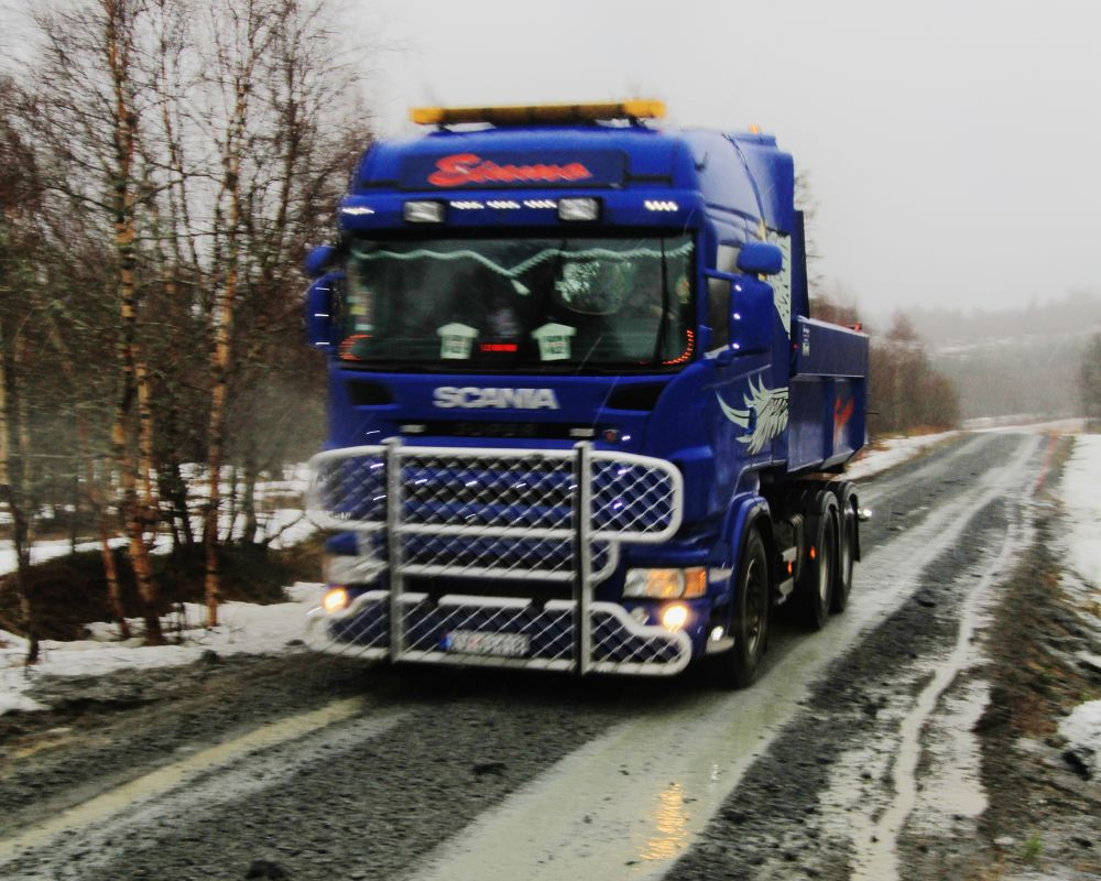 reparing the road that melting snow and rain water has washed out by vidar mathisen