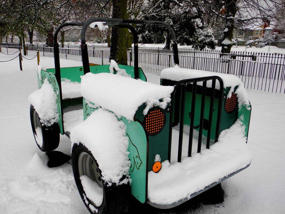 car in snow by emiljosthomas