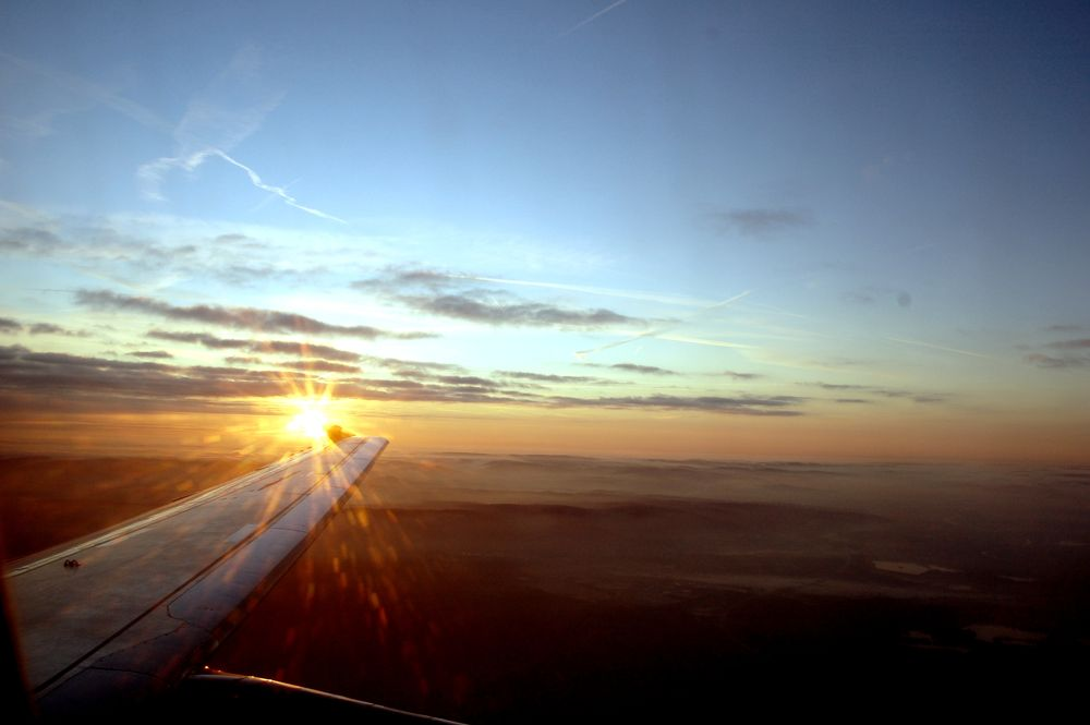 The sun from a plane by Val Jecov