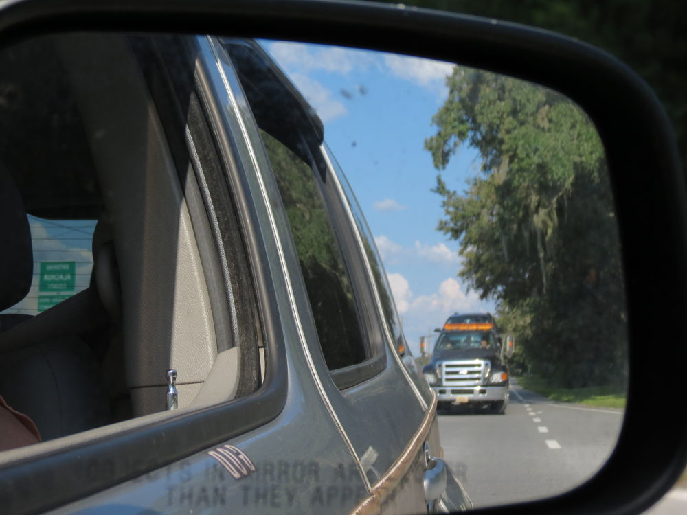 Rearview reflection by Linda L. Offen